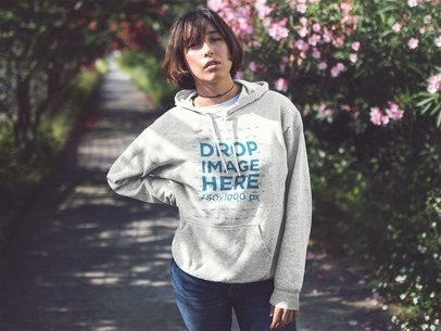 Pullover Hoodie Mockup of an Asian Girl Near a Flower Garden a12681