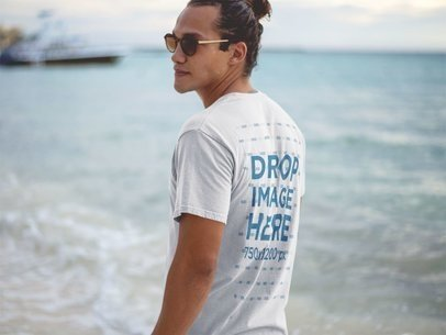 T-Shirt Mockup of a Hipster Guy Wearing Sunglasses at the Beach Shore a12726