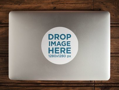 Sticker on Top of a MacBook Mockup a14308