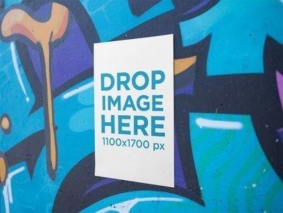 Vertical Poster on a Graffiti Wall Mockup a14411