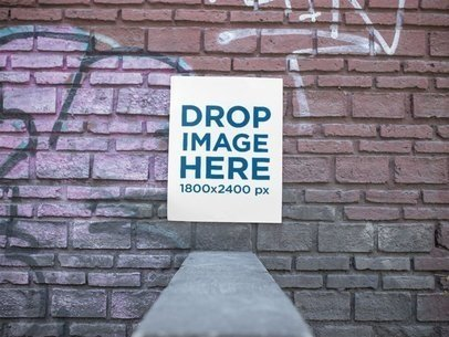 Poster on an Old Bricks Wall With Graffitis Mockup a14410