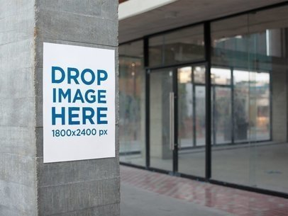 Poster on a Concrete Column Next to Stores for Rent Mockup a14461