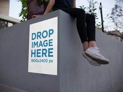 Poster on a Concrete Urban Structure with a Girl on Top of It Mockup a14463