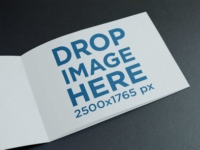 Horizontal Booklet on a Black Surface Mockup a14593