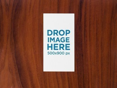 Vertical Business Card Mockup on a Wooden Surface a15000