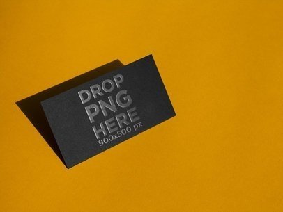 Horizontal Foil Business Card Mockup Standing Angled on a Yellow Surface a14989
