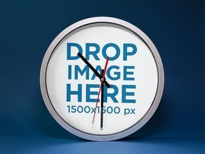 Mockup of a Round Clock Standing on a Blue Surface a15236