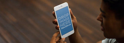iPhone 6 Mockup Template of a Man Holding an iPhone at Home a4910
