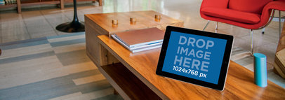 Tablet Mockup of an iPad Sitting on Top of a Wooden Coffee Table a4925