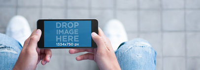 iPhone Mockup Featuring a Guy on the Street Using a Black iPhone 6 a5633