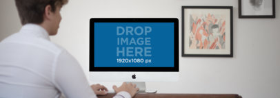 iMac Mockup of a Man Working at His Home Office a11782